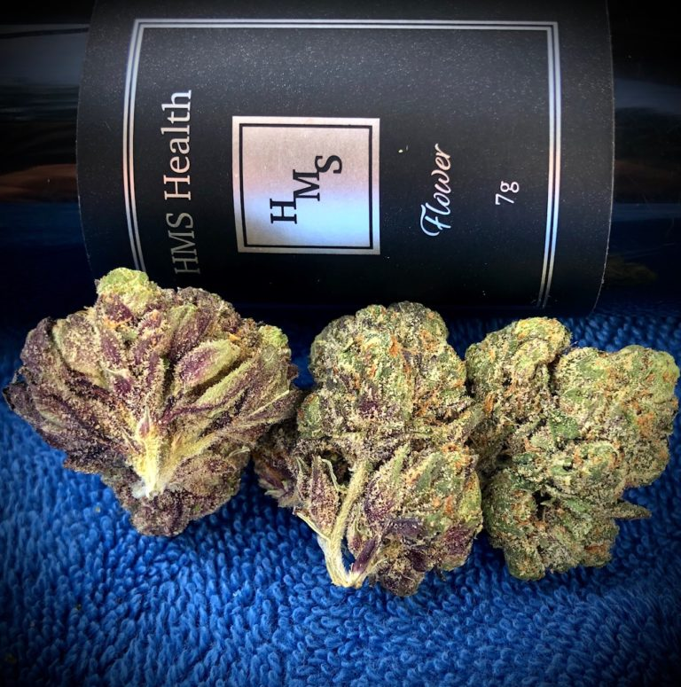 three buds of bully kush in front of hms bottle