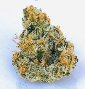 triangular shaped cured flower of poochie love cannabis strain